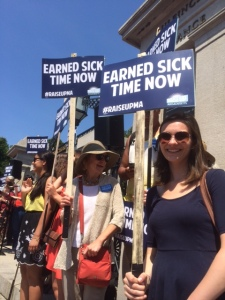 Kaitlyn with a sign_earned sick time